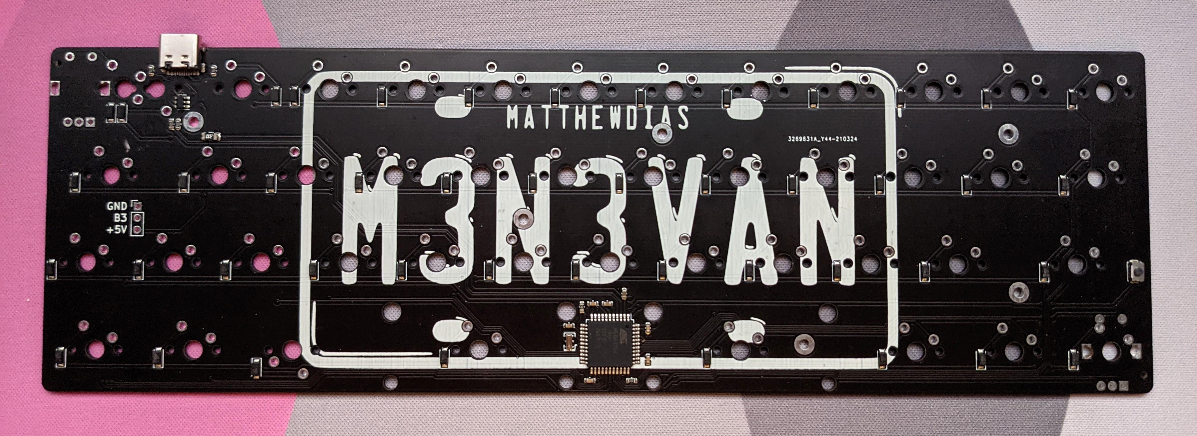 Back of a black m3n3van rev2 PCB