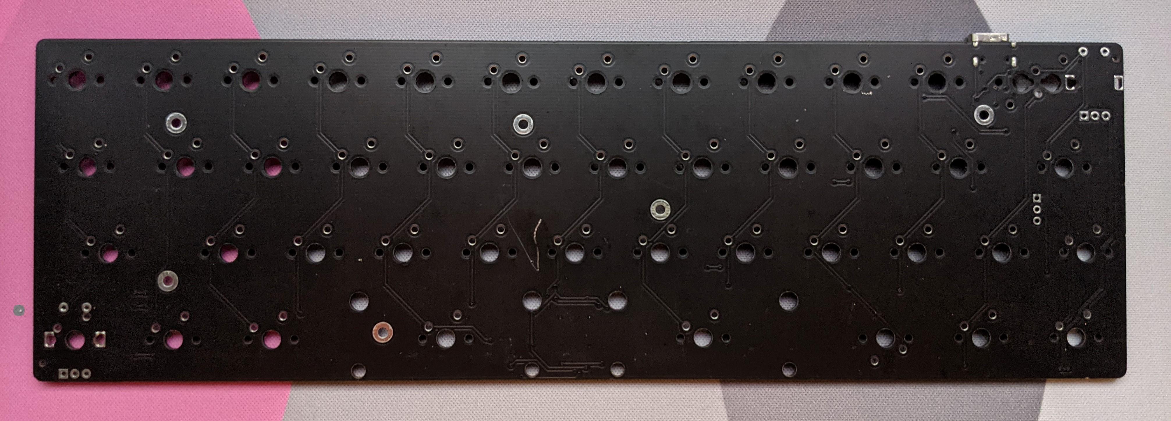 Front of a black m3n3van rev2 PCB