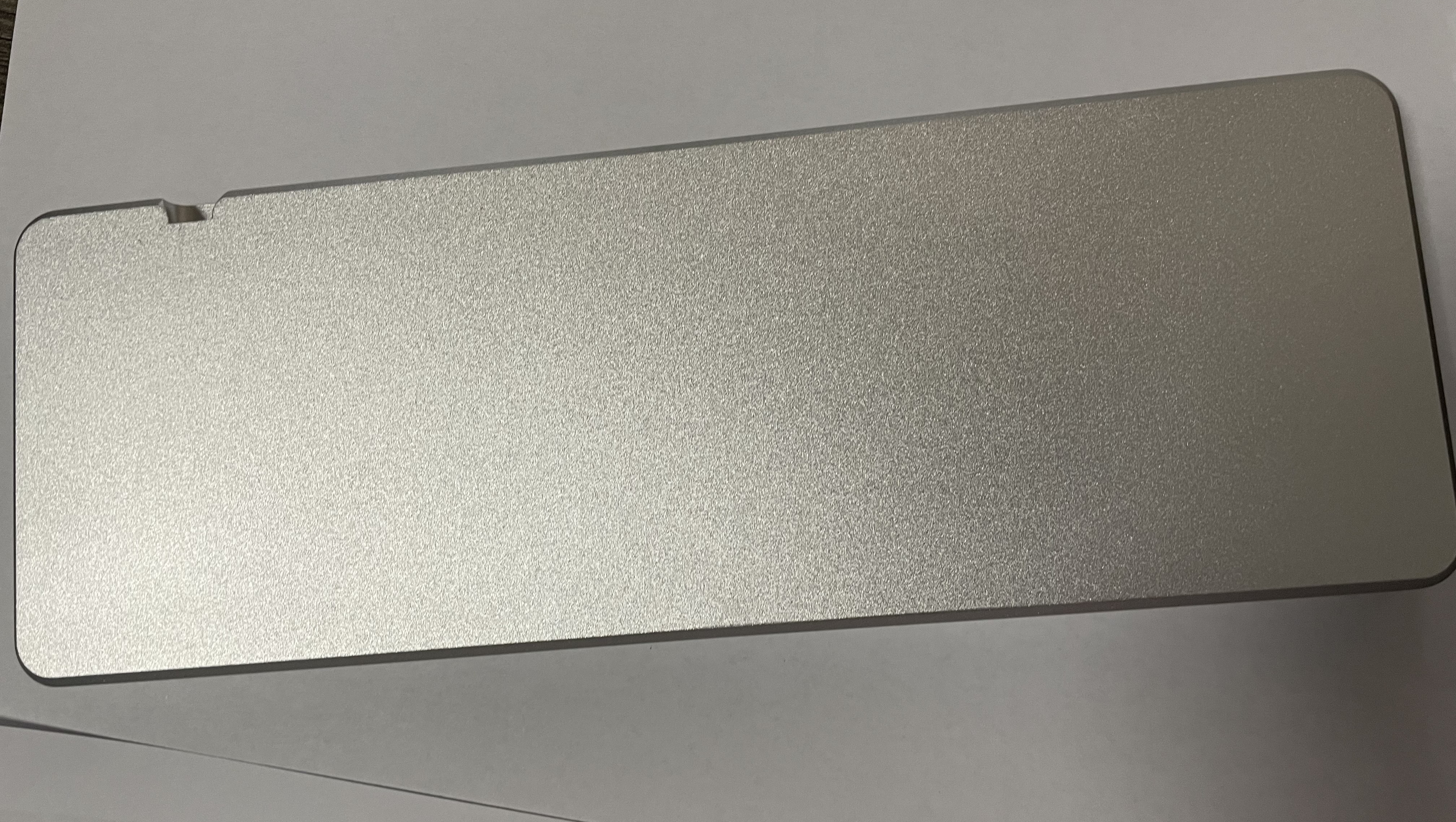 Bottom of a clear anodized aluminum 2nd revision prototype showing the sandblasted texture