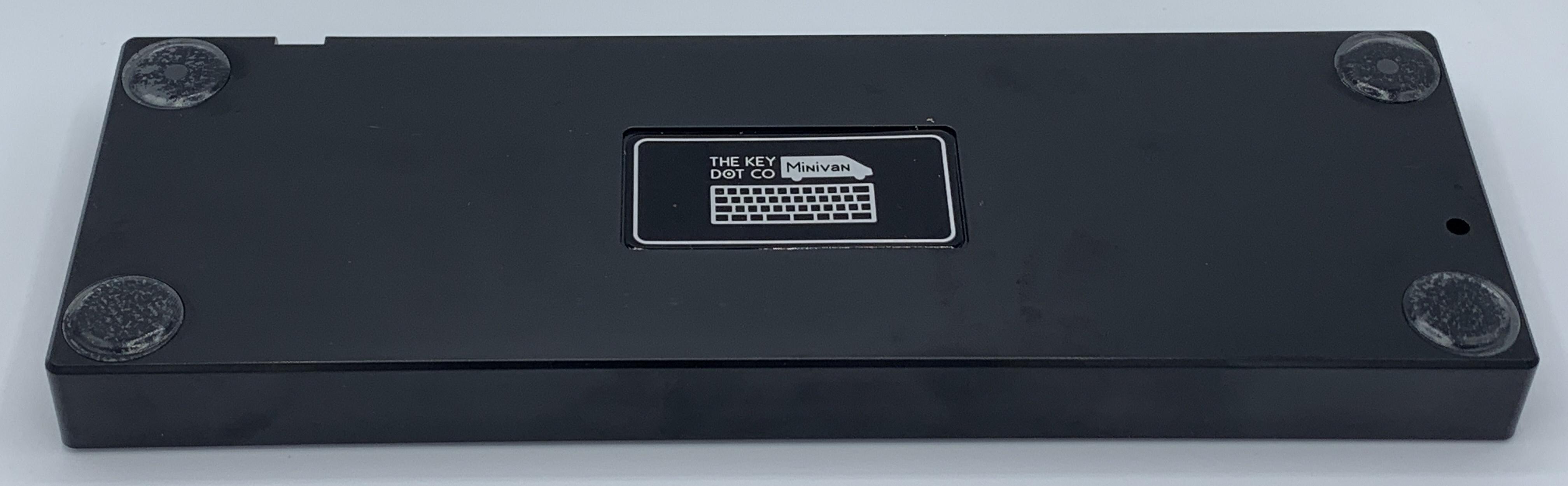 Bottom of the TheKey.Company black plastic case