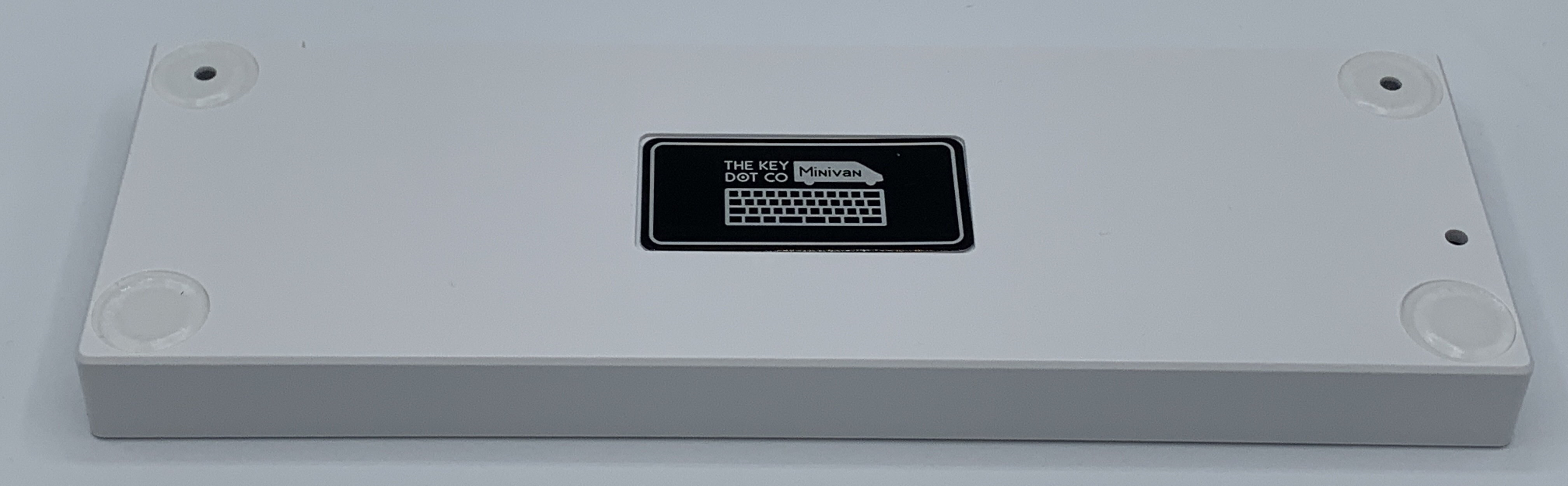 Bottom of the TheKey.Company white plastic case