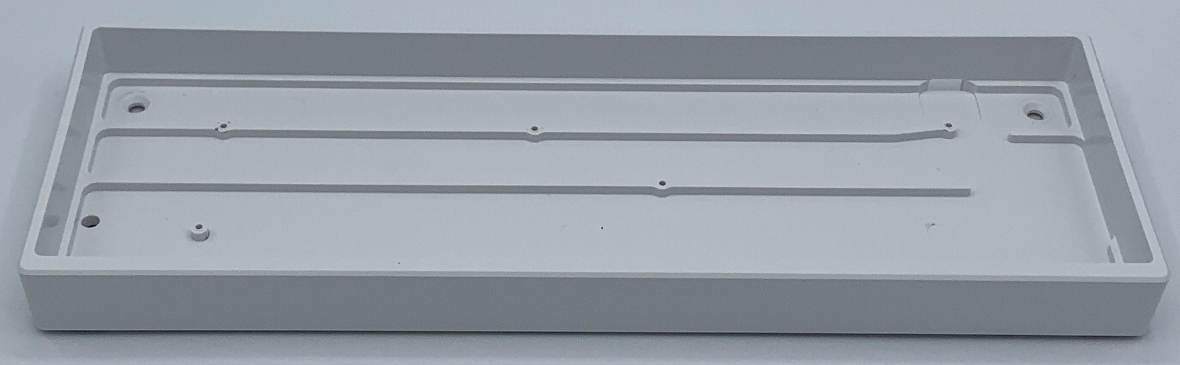 Inside of the TheKey.Company white plastic case