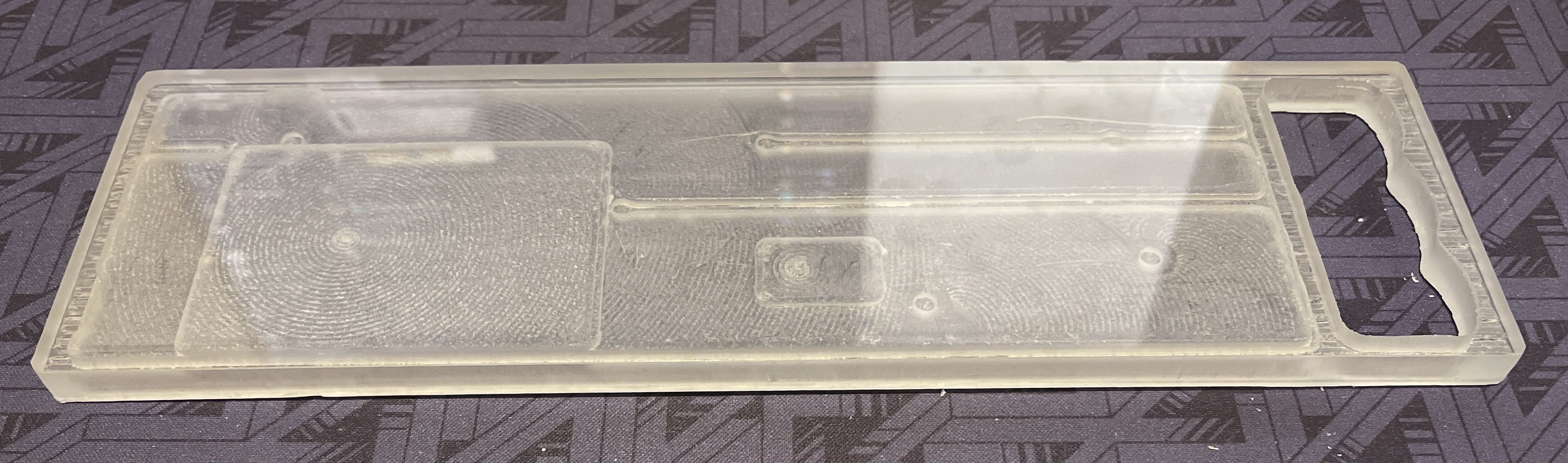 Bottom view of a polycarbonate Rackmount prototype showing cutouts for battery well and Bluetooth module