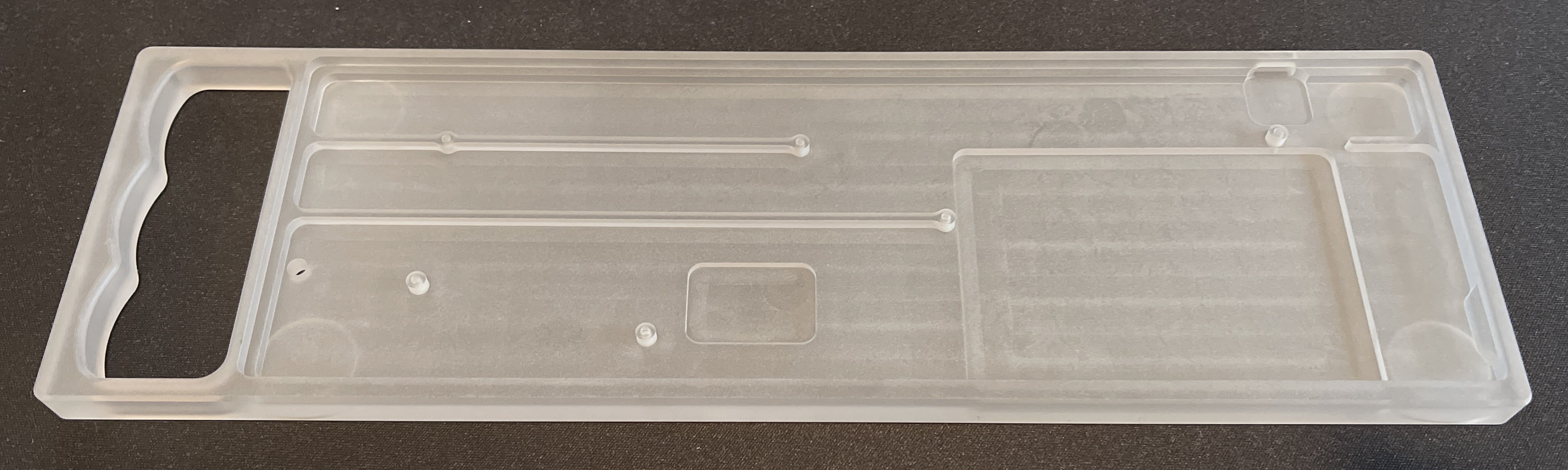 Top view of a polycarbonate Rackmount showing cutouts for the Bluetooth module (center) and battery well (right)