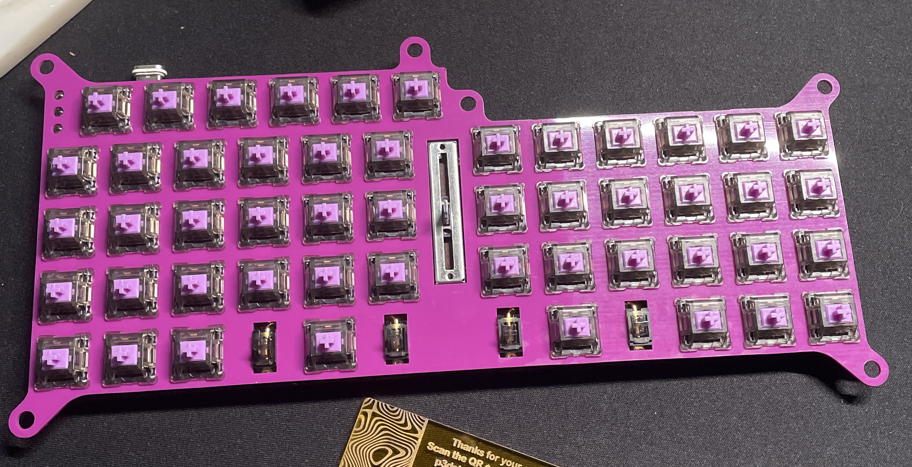 Purple POM plate for P3DStore V4N4G0N case showing the unique mounting hole layout